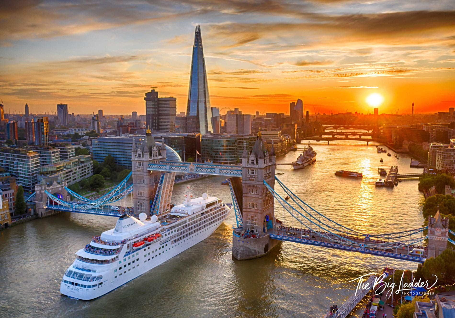 Cruise liner passes through Tower Bridge.